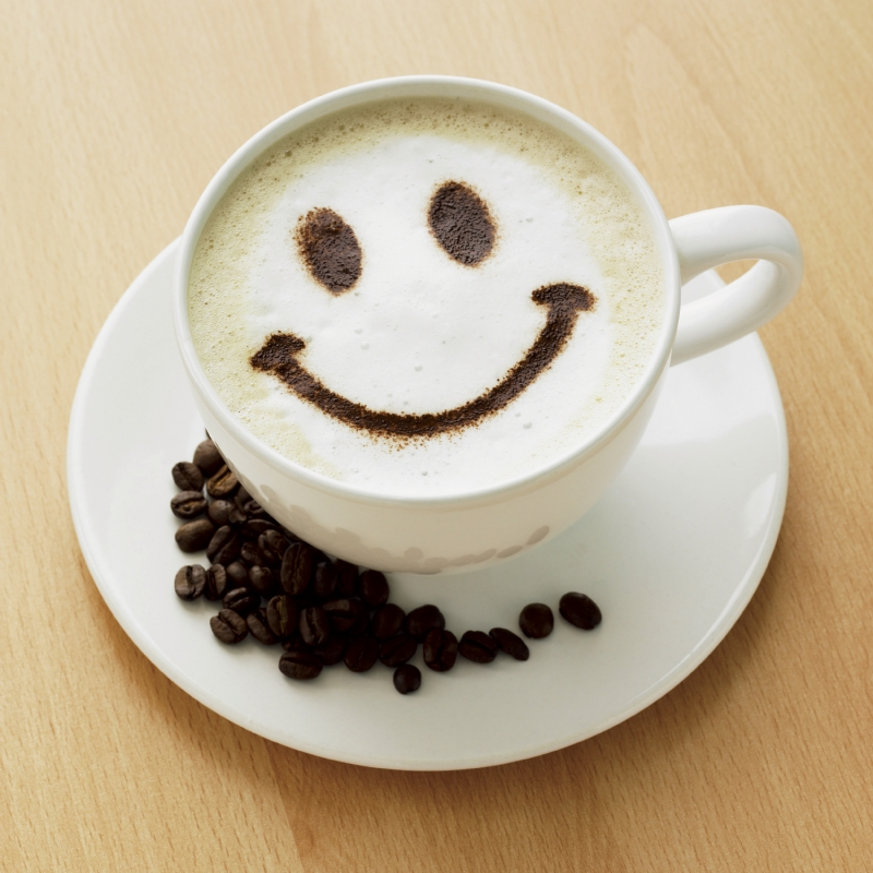 tasse à café avec un sourir
